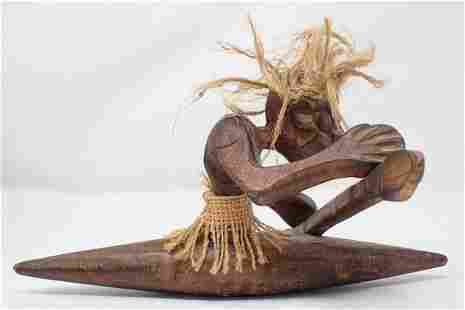 Wood Carved African Tribal Figure in Canoe