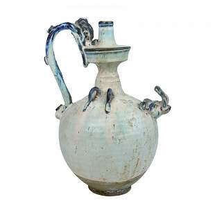 A White Glazed Dragon handle Ewer of Tang Style.