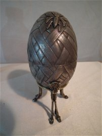FABERGE SILVER EGG ON STAND