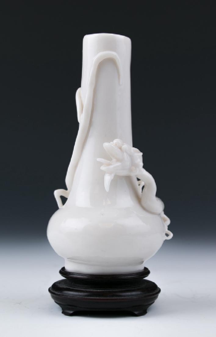 A White Glazed Dragon Vase