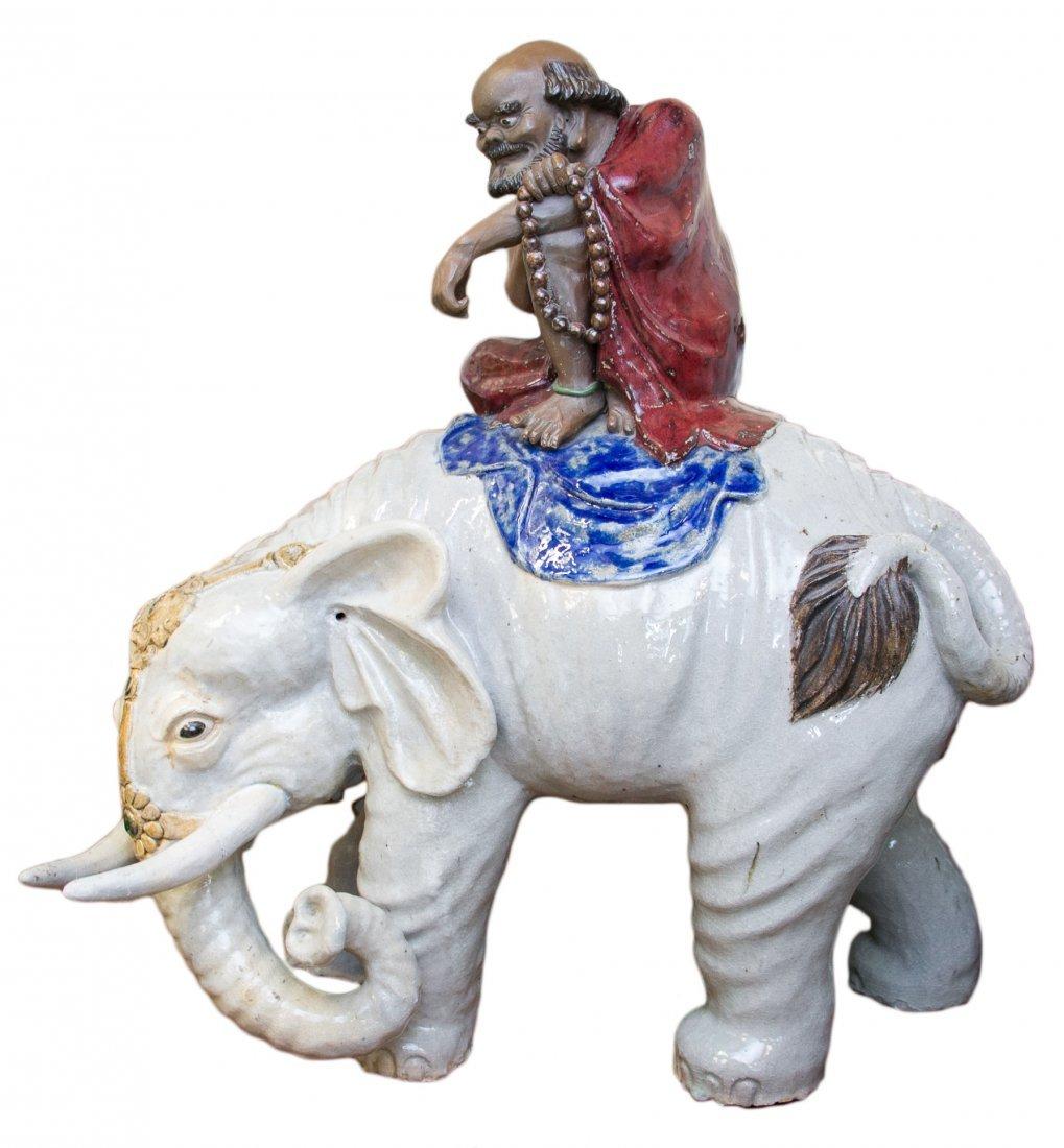 A Giant Shiwan Daruma Riding on an Elephant , Late Qing