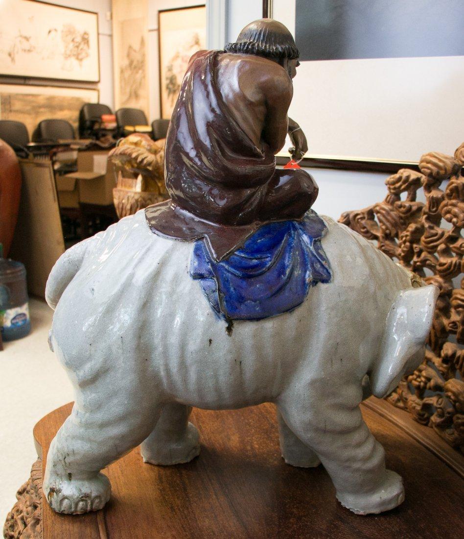 A Giant Shiwan Daruma Riding on an Elephant , Late Qing - 4