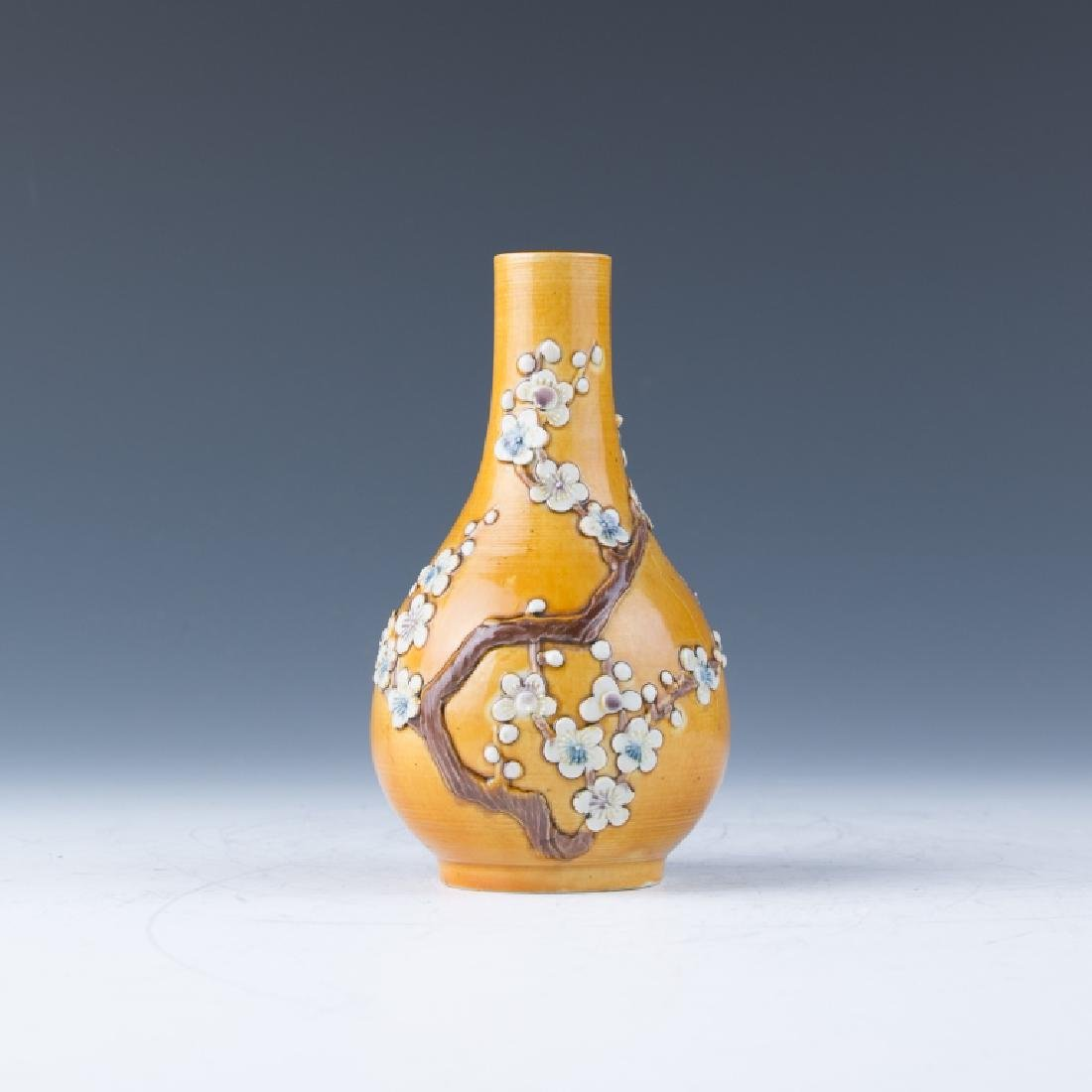 A Yellow Ground Famille Rose Vase