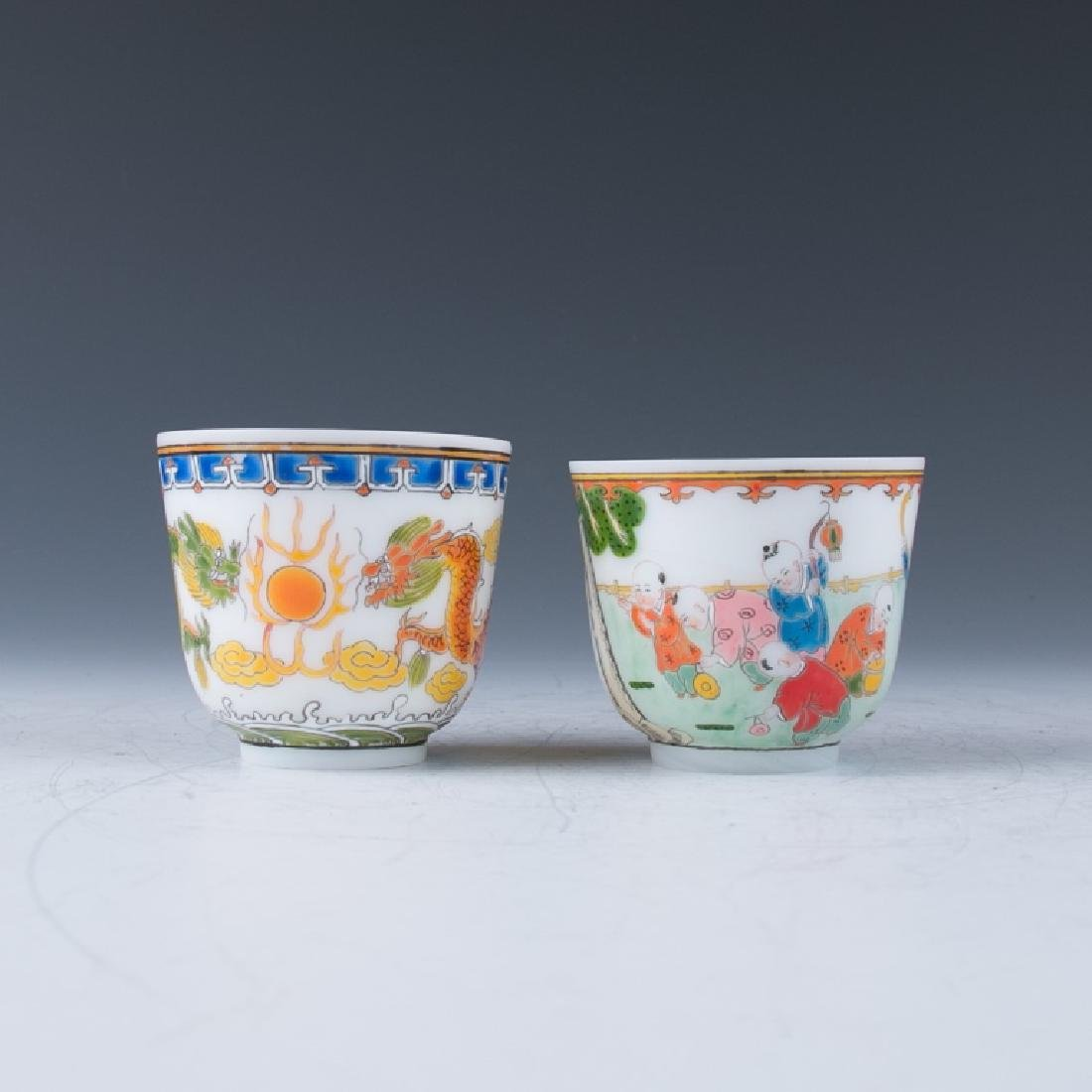 Two White Glass Cups