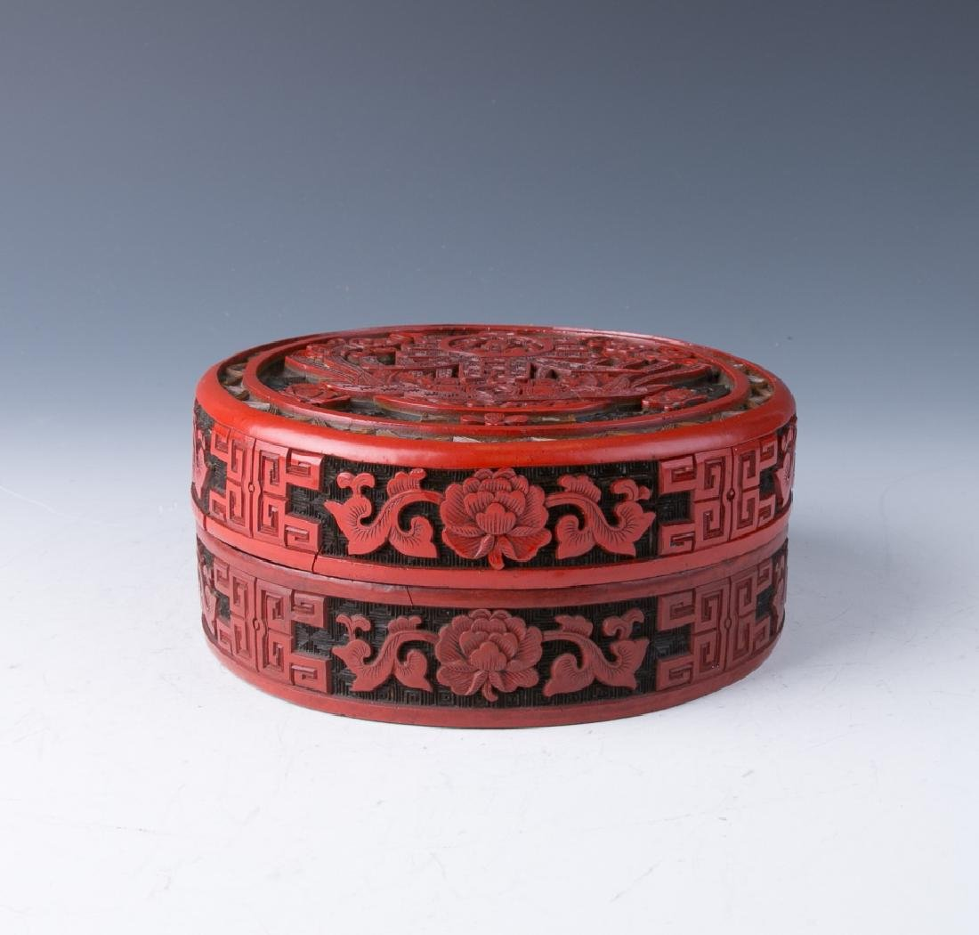 A Circular Carved Cinnabar Lacquer Box and Cover