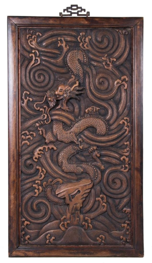 A Wood Carved Panel