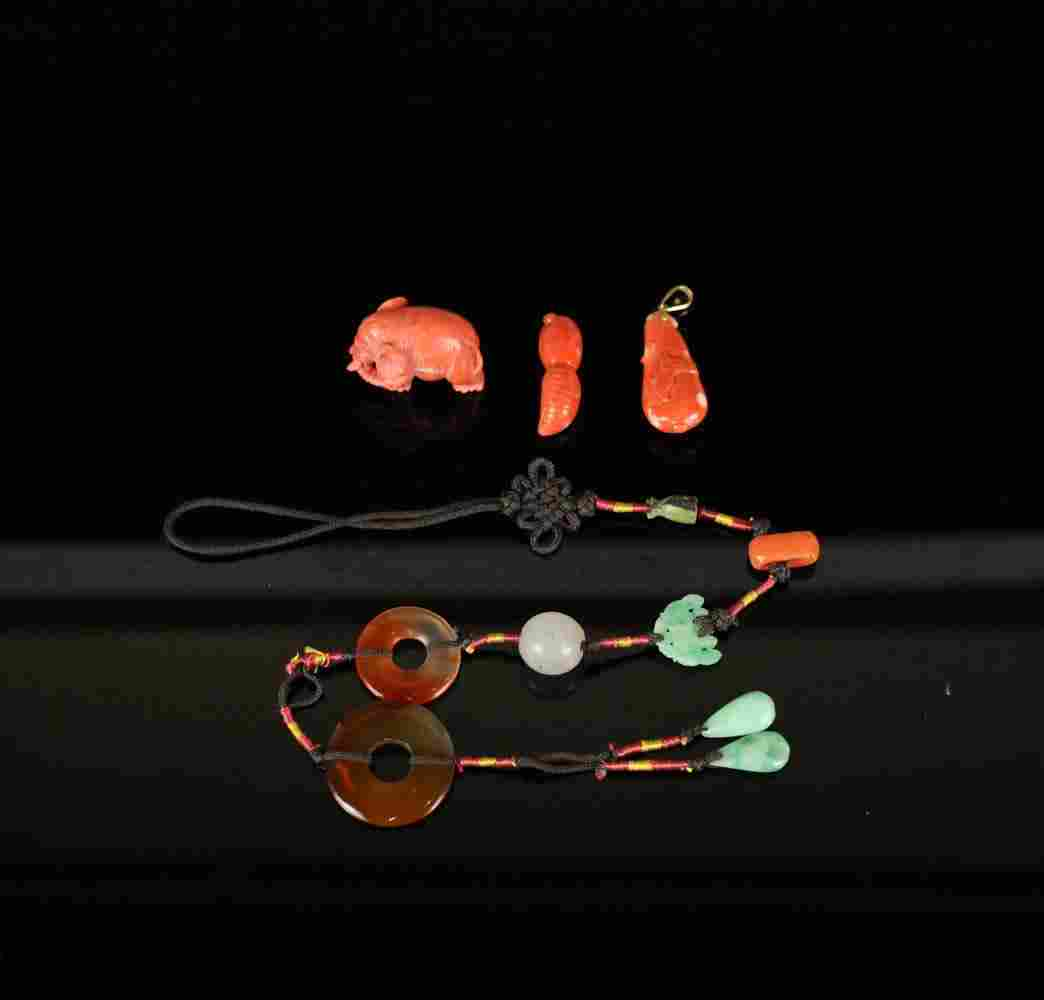 A GROUP OF CORAL AND JADIETE ACCESSORIES