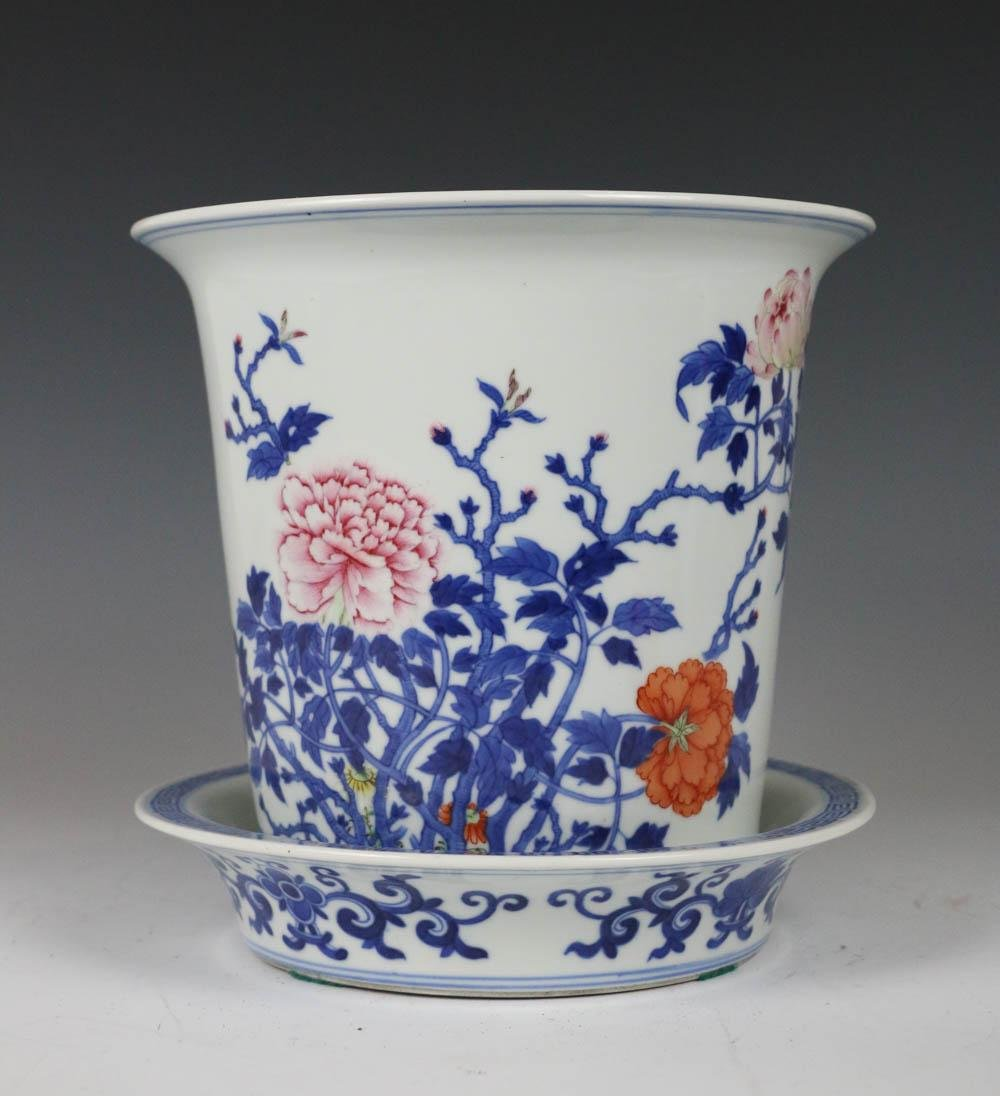 A BLUE AND WHITE  PLANTER WITH BASE PLATE,19 TH C