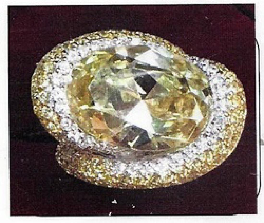 Lady's silver yellow stone ring