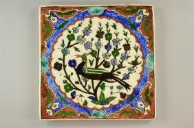 Armenian Tile with a a drawing of a Bird on a tree in