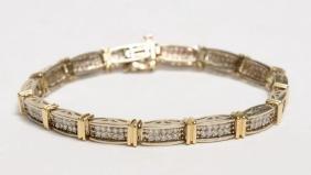 14 Karat gold tennis bracelet, weight 21 gr., set with