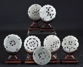 7 Chinese Carved Jade Bi-discs With Rosewood Stand