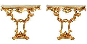 Pr. Carved Gilt Wood Consoles with Onyx Tops
