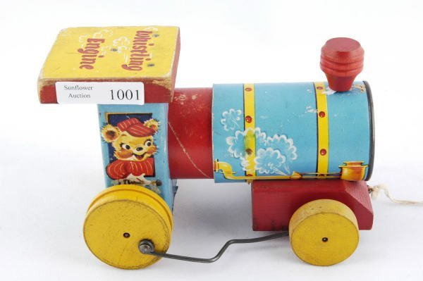 1001: 1957 Fisher Price Whistling Engine #617 Pull Toy