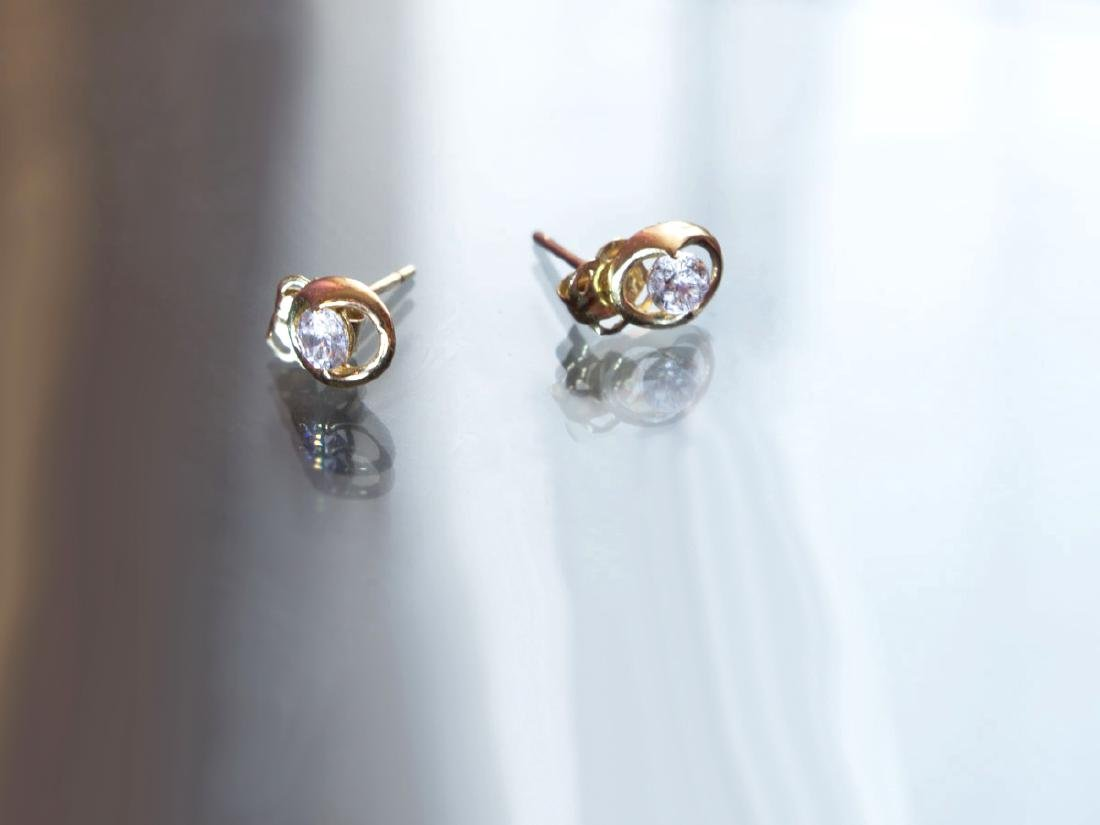 Gold 14 kt earrings with brilliant cut zirconia