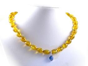 Baltic amber necklace with blue zirconia pendant