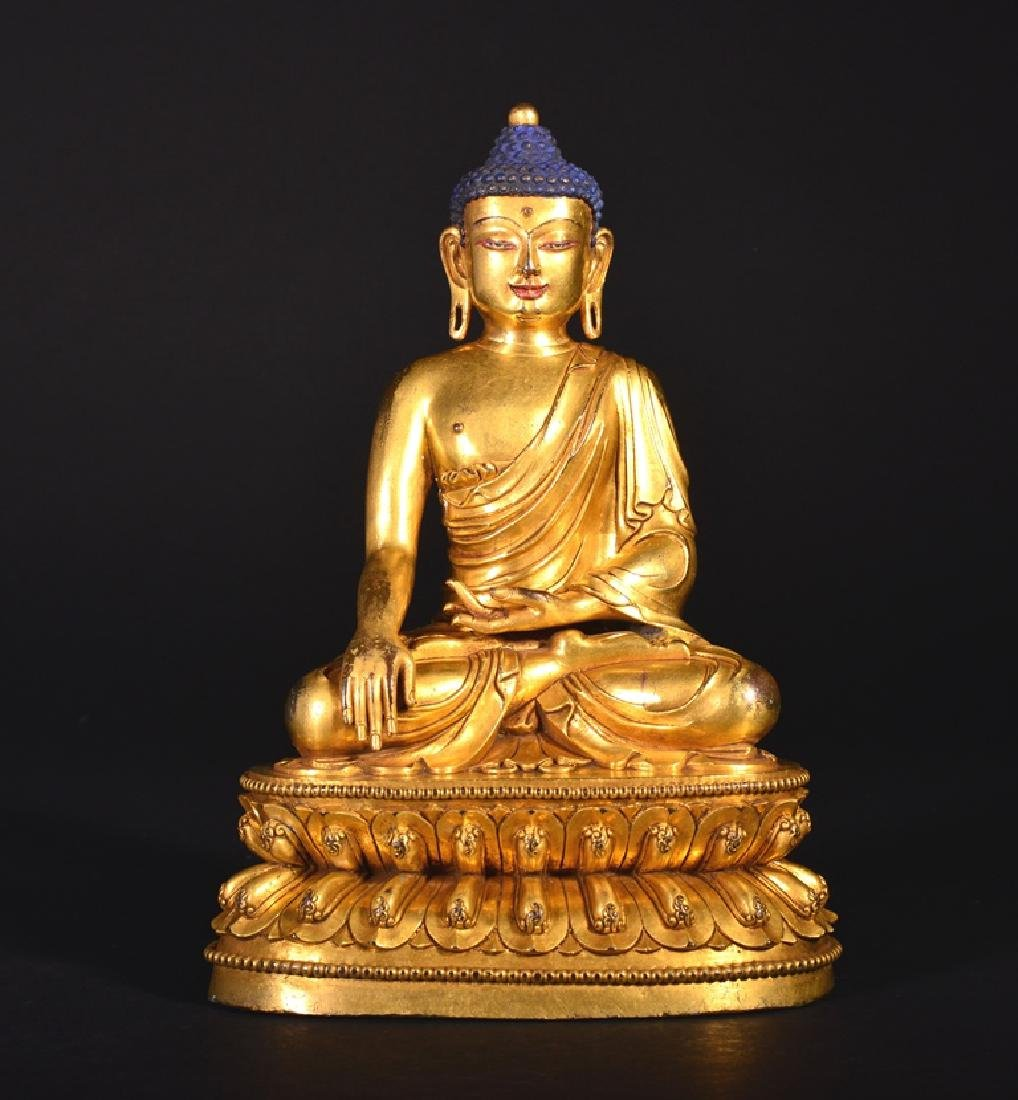 A GILT-BRONZE FIGURE OF BUDDHA, MING DYNASTY