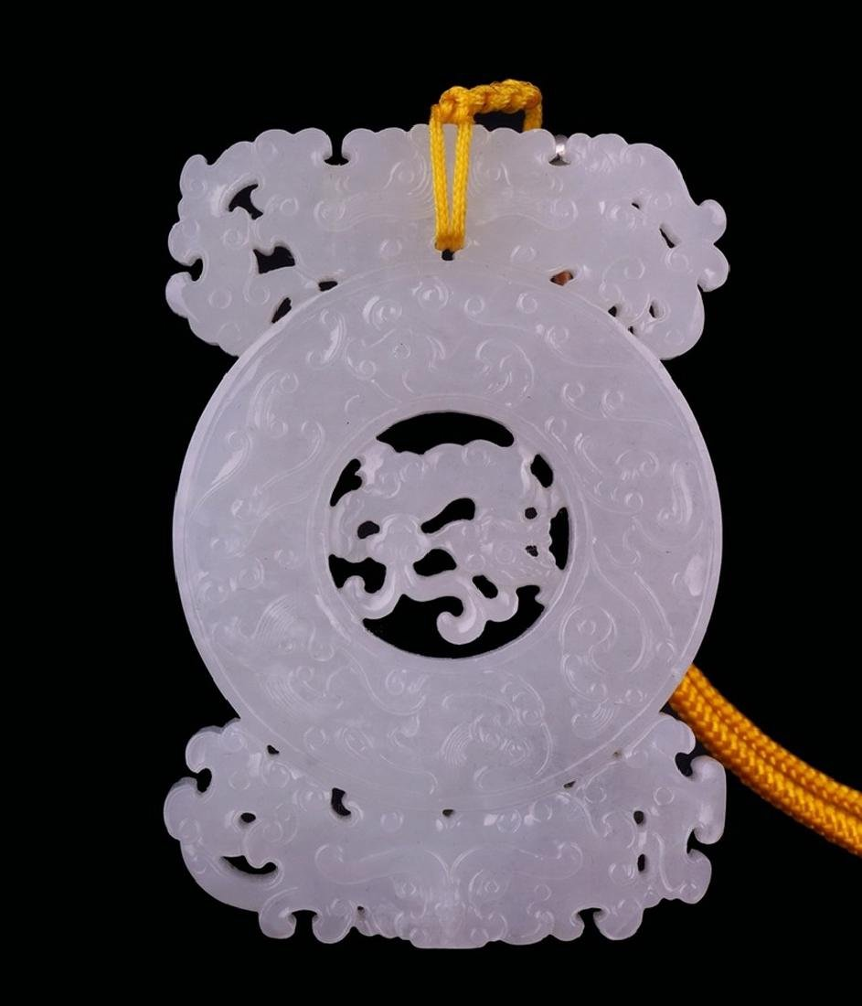 A CARVED WHITE JADE DRAGON PENDANT , Qing Dynasty