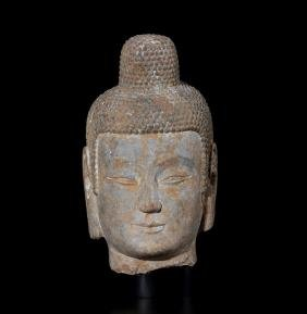 A CARVED LIMESTONE HEAD OF BUDDHA , Northern Wei