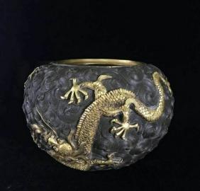A GILT-BRONZE DRAGON BOWL , Qing Dynasty
