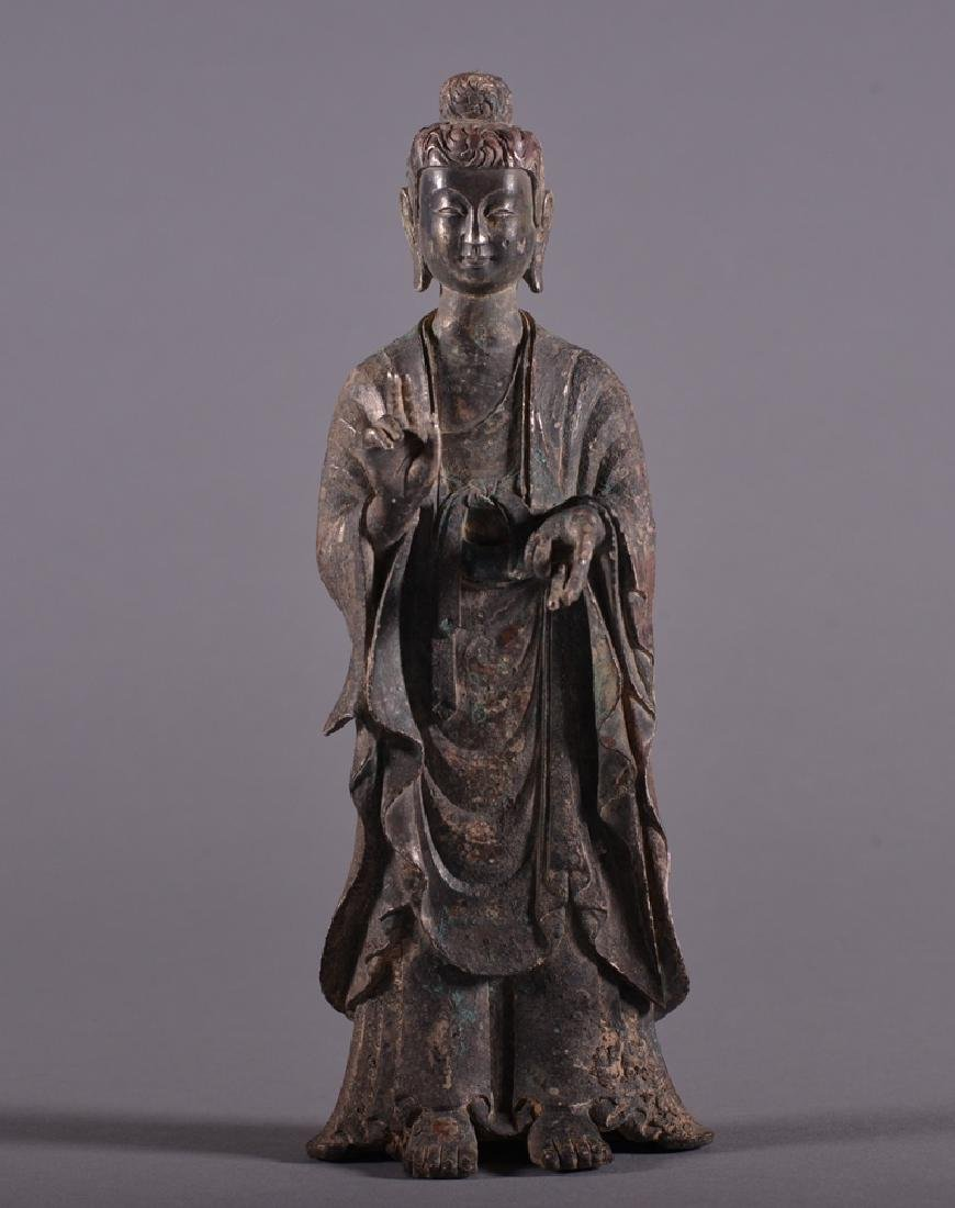 A SILVER FIGURE OF BUDDHA.