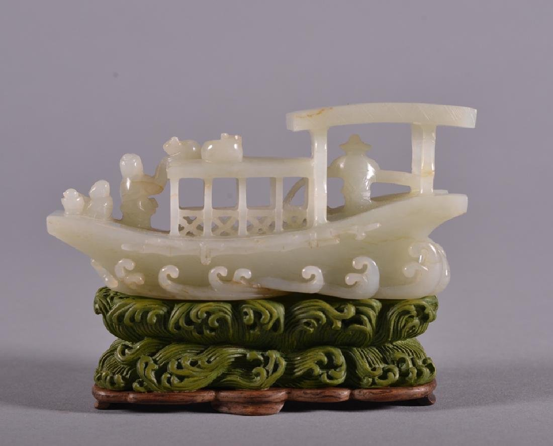 A CARVED WHITE JADE BOAT.