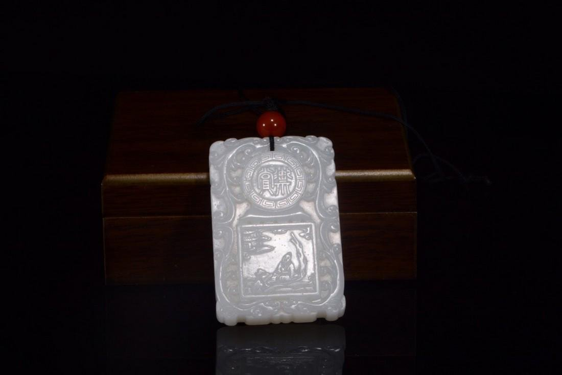 A CARVED WHITE JADE PENDANT.QING PERIOD