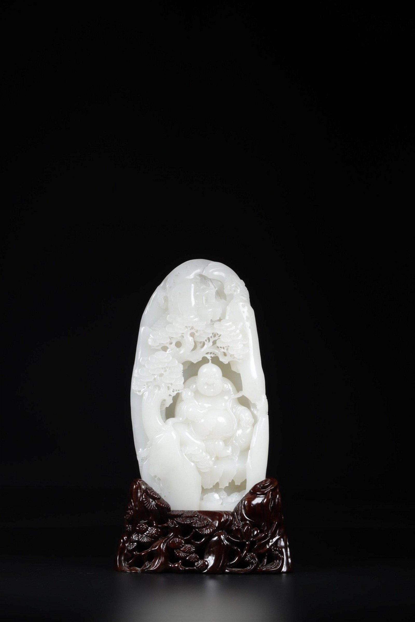 A CARVED WHITE JADE 'BUDDHA' BOULDER.QING PERIOD