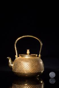 A CARVED JAPANESE GILTSILVER TEAPOT AND COVERANTIQUE