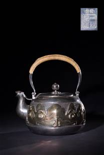 A CARVED GILTSILVER TEAPOT AND COVERANTIQUE