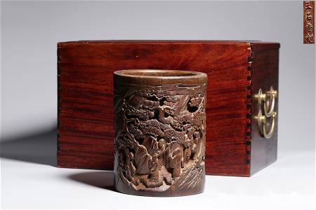 A CARVED BAMBOO 'LANDSCAPE' BRUSHPOT.QING PERIOD