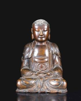 A CARVED TANGXIANGMU BUDDHA