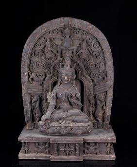 A  CARVED WOODEN TARA