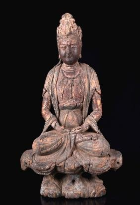 A CARVED WOODEN  GUANYIN