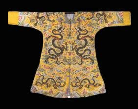 AN IMPERIAL YELLOW BROCADE EMBROIDERED SILK DRAGON ROBE