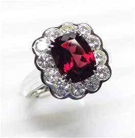 14 K White Gold, Garnet And Diamond Ring
