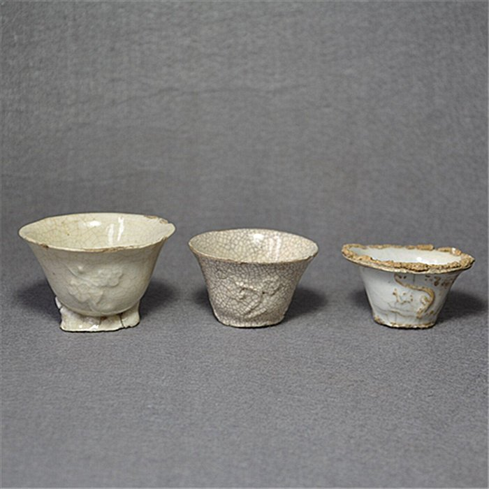 A Set of Three Old  Blanc De Chine Plum Cups