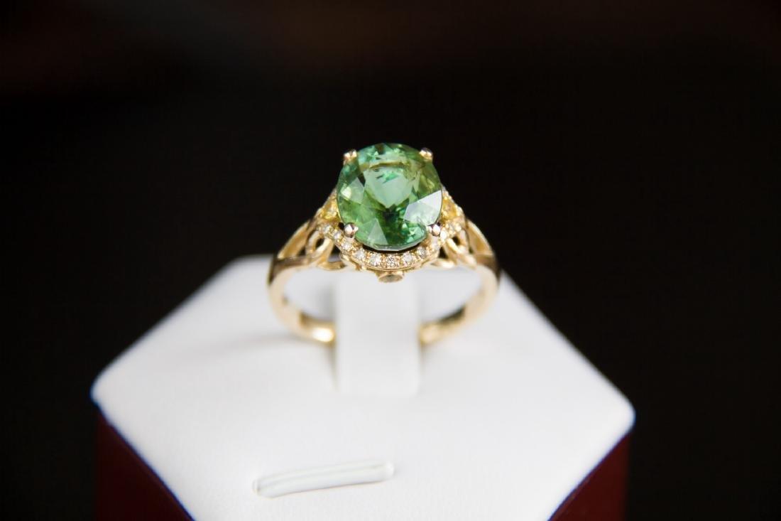 6 ct. green tourmaline ring with diamonds and yellow sa