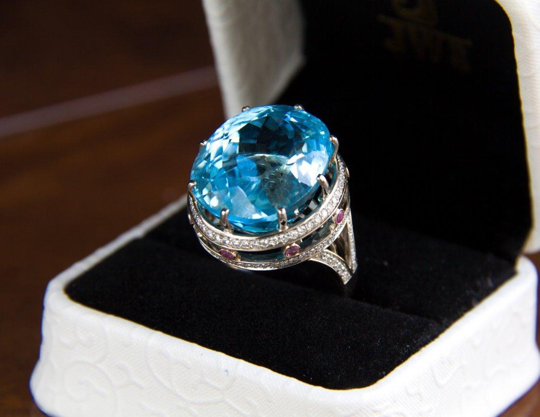 Massive 28 ct. topaze, diamonds and rubies ring