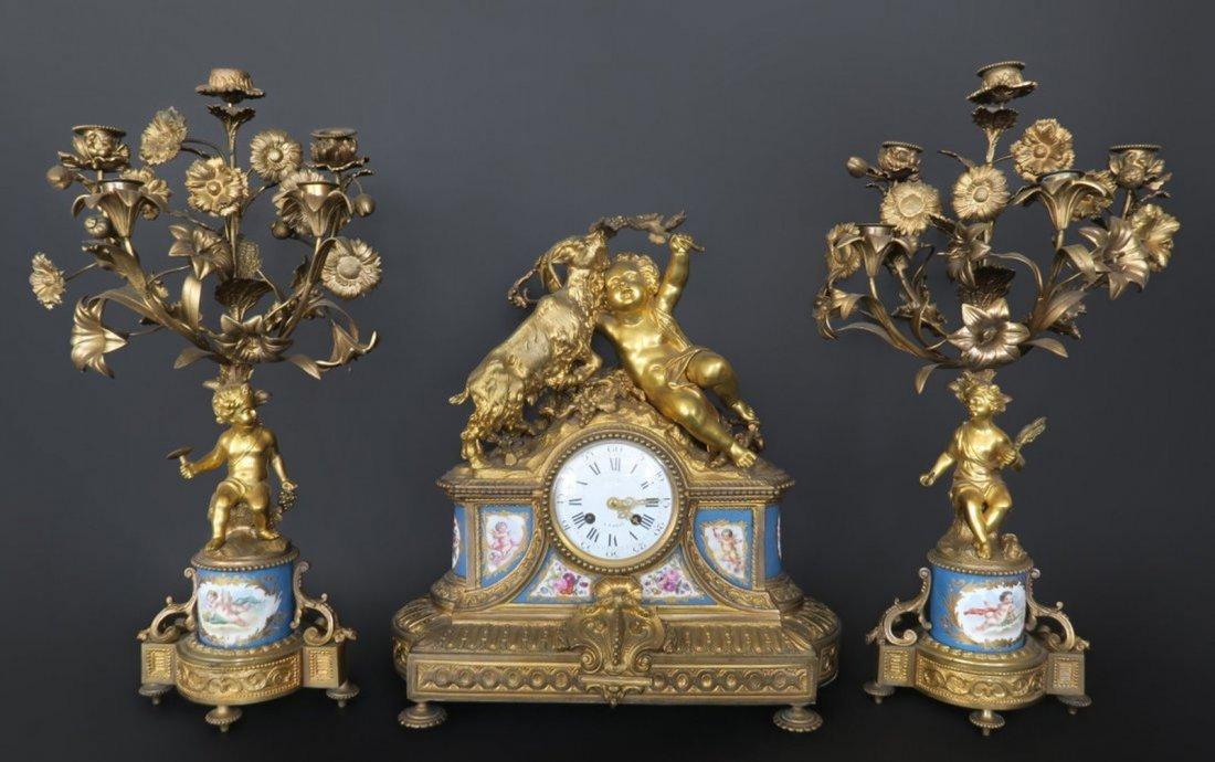 French Gilt Bronze And Sevres Porcelain Clock Set