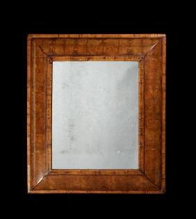 A large William & Mary walnut oyster veneered mirror