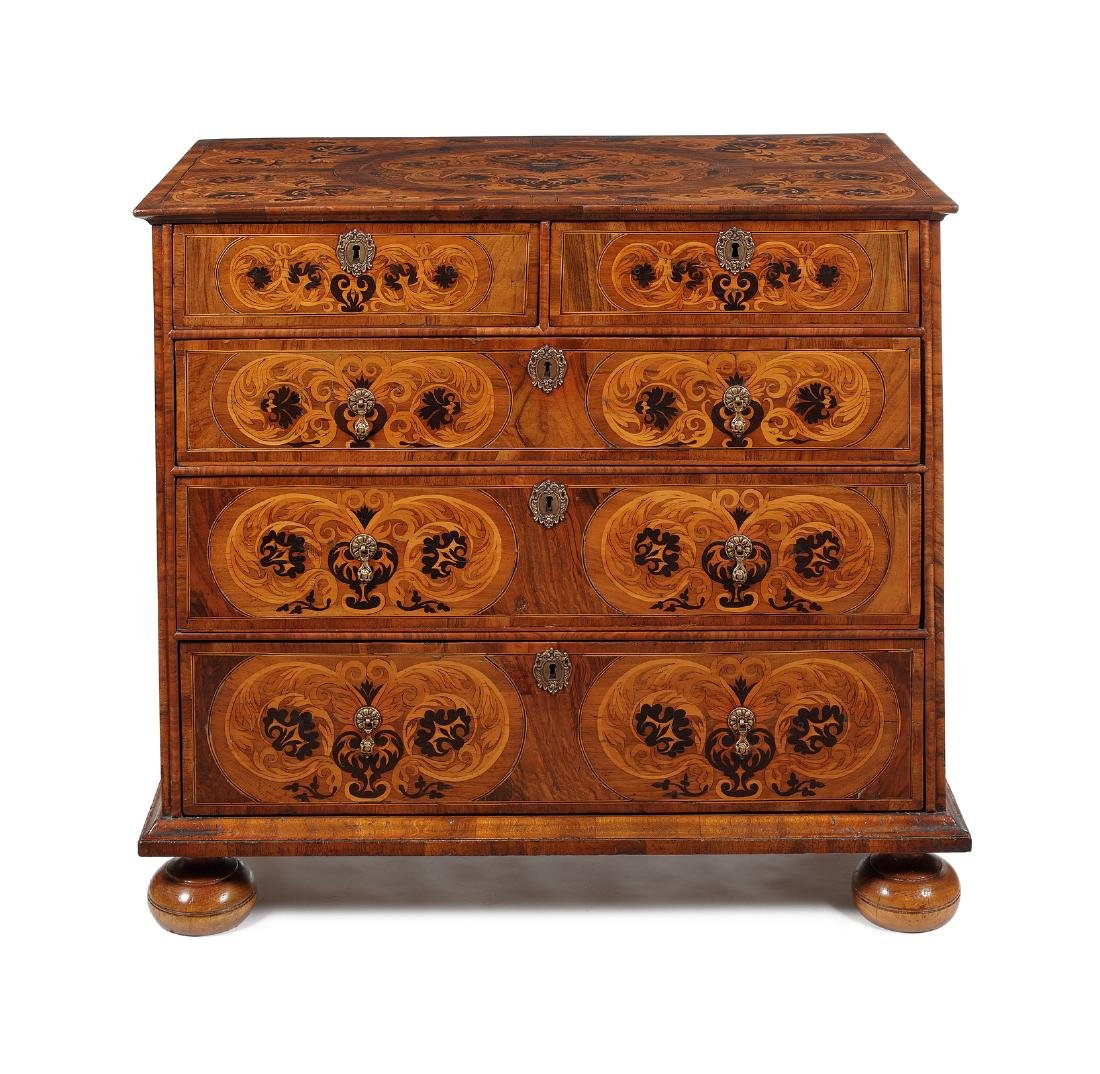 A George I walnut, sycamore and ebony marquetry chest