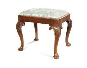 A George I carved walnut stool