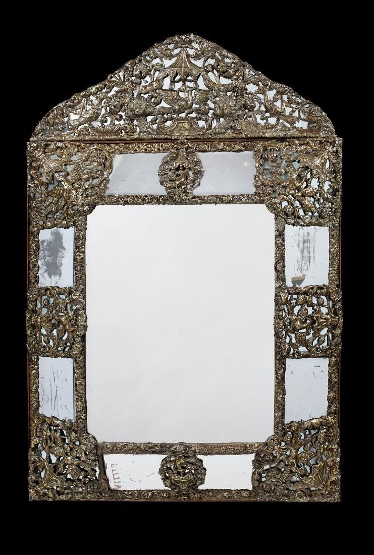 A 17th century Flemish repoussé gilt-brass mirror