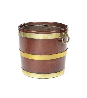 A George III mahogany and brass bound bucket