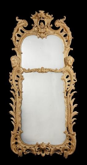 A large and impressive George II style gilt pier mirror