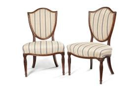 A pair of George III carved mahogany side chairs