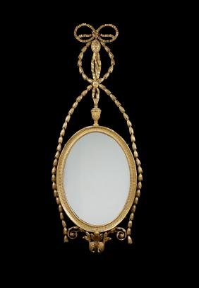 A carved giltwood pier mirror, George III & later