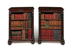 A pair of Regency style carved rosewood open bookcases