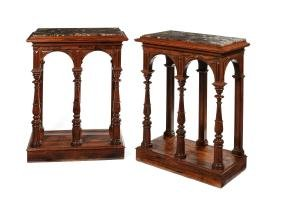 A pair of William IV carved rosewood console tables